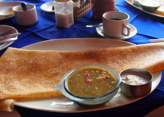 Indian food. Dosa with sambol and cconut chutney. A South Indian dish.