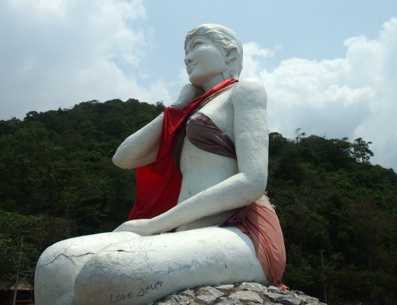 This statue at Kep, Cambodia, the white lady, is regularly dressed by locals to protect her modesty.
