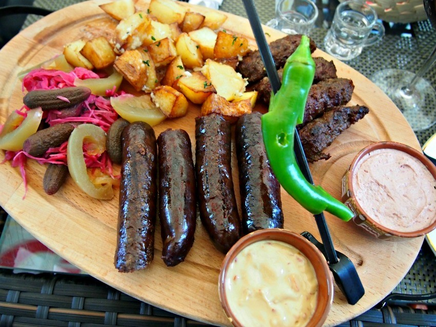 Romanian restaurant meal, venison sausages, mici, pate, potatoes