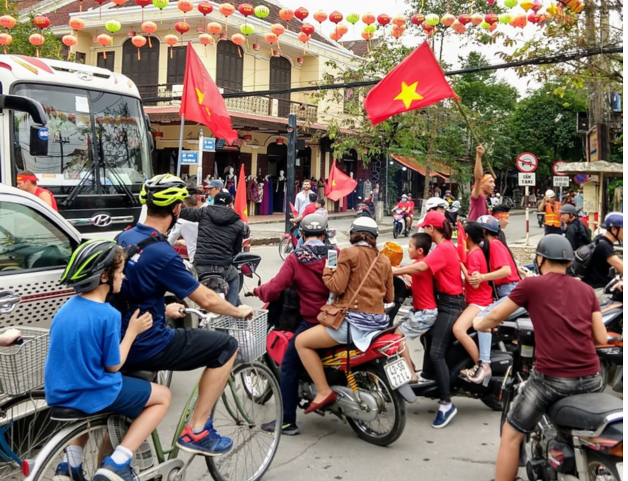 Vietnam transport bikes, motorbikes cars and buses organised chaos